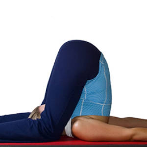 Karnapidasana – Ear Pressure Pose, Knee to Ear Pose